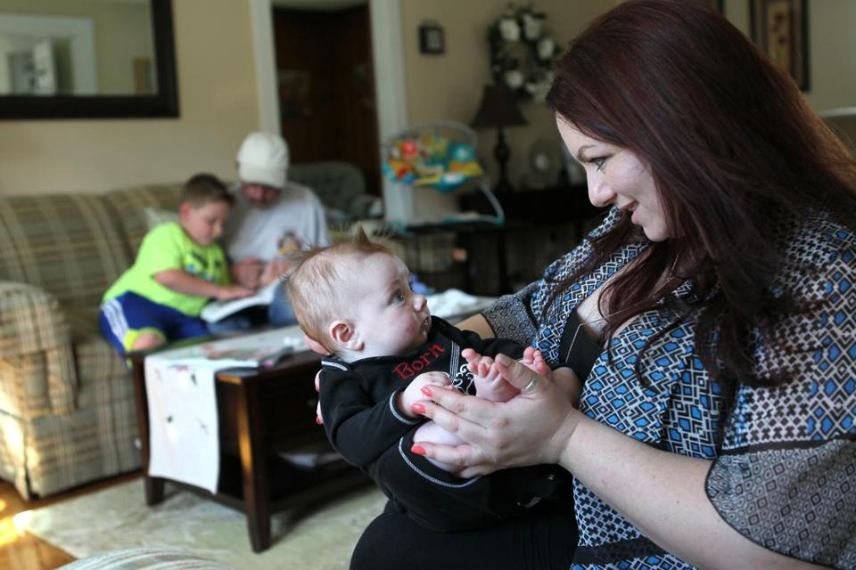 Michelle Frigon talked to Charlie, 4 months, as her son William, 7, read with his grandfather.